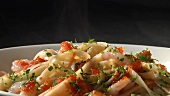 Ribbon pasta with prawns, tomato sauce and parsley