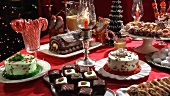 Biscuits, cakes and gingerbread house on Christmas cake buffet