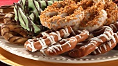 Iced and chocolate-coated pretzels