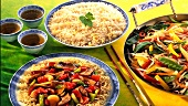Rice, stir-fried vegetables, sweet and sour pork with egg noodles