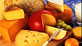 Various cheeses with grapes