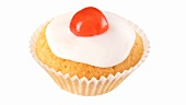 A cupcake with a glacé cherry