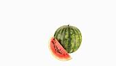Ganze Wassermelone und Melonenschnitz