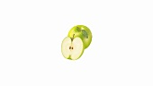 Granny Smith apples, whole and a half