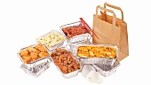 Various dishes in aluminium packaging