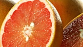 Grapefruits, whole and halved