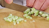 Finely chopping prepared cucumber