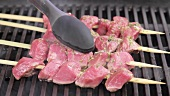 Marinated lamb kebabs being barbecued