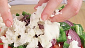 Feta being added to salad