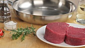 Beef fillet steaks, herbs, spices, a pan and oil