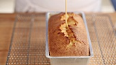 Testing a loaf cake with a wooden stick