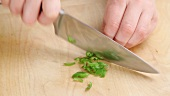 Chopping a green chilli