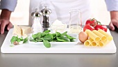 Ingredients for cannelloni with a spinach and ricotta filling