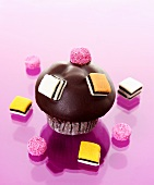 Muffin with chocolate icing and liquorice allsorts