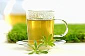 Glass and tea pot of woodruff tea