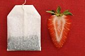 Sliced strawberry by tea bag