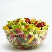 Mixed salad in plastic bowl, close-up