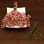 Fresh green and red peppercorns, elevated view