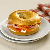 Bagel filled with salmon, cream cheese and onion