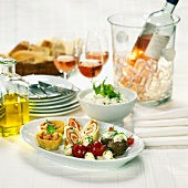 Antipasto romano (Assorted appetisers with rosé wine, Italy)