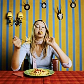 Young woman eating chips with ketchup