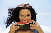Young woman eating watermelon, portrait