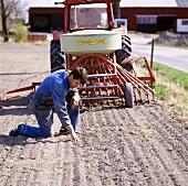 Farmer drilling cereals