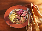 Hare loin fillet in cranberry sauce with spaetzle & red cabbage