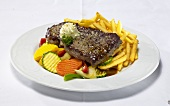 Rump steak with chips and summer vegetables