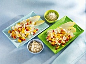 Chicory and mango salad with sprouts and flaked almonds