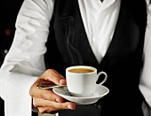Waiter serving espresso