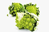 Romanesco broccoli, two whole and one halved