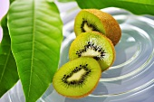 Partly sliced kiwi fruit