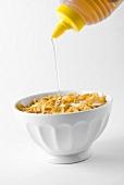 Putting honey on cornflakes