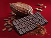Bar of chocolate, cocoa powder, cacao fruit and cocoa beans