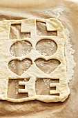 Biscuit dough with the word 'LOVE' cut out twice