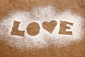 The word 'LOVE' in icing sugar