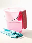 Pink cleaning bucket with rubber gloves