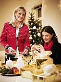Two women wrapping presents
