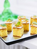 Squares of orange cake with fresh mint