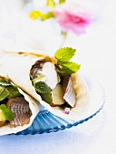 Wraps filled with herring, potatoes and sour cream
