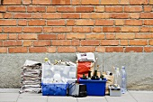 Waste sorted for recycling by brick wall