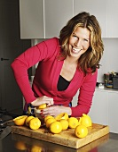 Woman squeezing lemons