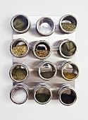 Assorted spices in screw-top jars (overhead view)