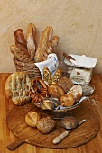 Various types of bread and bread rolls, flour on scales