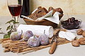Goats' cheese log with figs, nuts, olives, bread & red wine