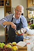 Elderly man cooking