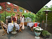 People at a garden party on a terrace