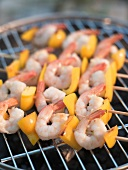 Prawn and pepper skewers on a barbecue