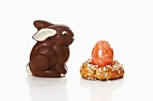 Coloured egg in baked egg cup and chocolate Easter Bunny